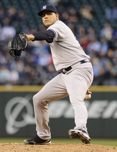 Jun 10, 2014; Seattle, WA, USA; New York Yankees relief pitcher Dellin Betances (68) pitches to the Seattle Mariners during the sixth inning at Safeco Field. Mandatory Credit: Steven Bisig-USA TODAY Sports