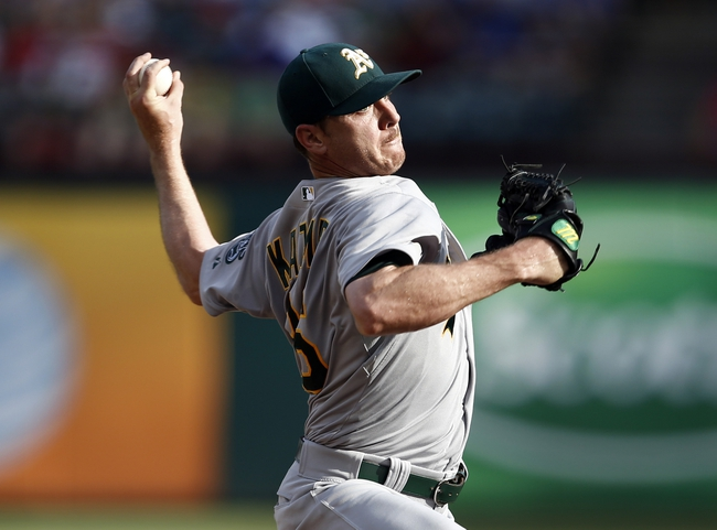 Jul 27, 2014; Arlington, TX, USA; Oakland Athletics starting pitcher Scott Kazmir (26) delivers a pitch to the Texas Rangers during the first inning of a baseball game at Globe Life Park in Arlington. Mandatory Credit: Jim Cowsert-USA TODAY Sports