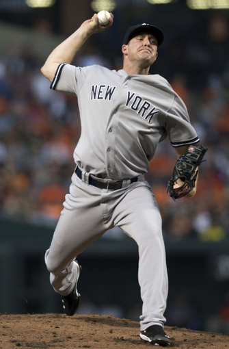 Jul 13, 2014; Baltimore, MD, USA; New York Yankees starting pitcher Chase Whitley (39) pitches during the during the first inning against the Baltimore Orioles at Oriole Park at Camden Yards. Mandatory Credit: Tommy Gilligan-USA TODAY Sports