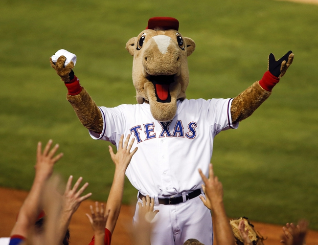 Jul 27, 2014; Arlington, TX, USA; Texas Rangers mascot Captain engages fans during the seventh inning of a baseball game against the Oakland Athletics at Globe Life Park in Arlington. The Athletics won 9-3. Mandatory Credit: Jim Cowsert-USA TODAY Sports