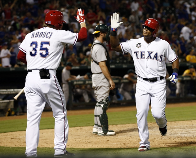 Jul 27, 2014; Arlington, TX, USA; Texas Rangers third baseman Adrian Beltre (29) is congratulated by right fielder Jim Adduci (35) after scoring on his solo home run against the Oakland Athletics during the eighth inning of a baseball game at Globe Life Park in Arlington. The Athletics won 9-3. Mandatory Credit: Jim Cowsert-USA TODAY Sports