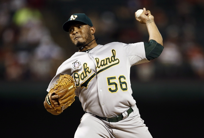 Jul 27, 2014; Arlington, TX, USA; Oakland Athletics relief pitcher Fernando Abad (56) delivers to the Texas Rangers during the ninth inning of a baseball game at Globe Life Park in Arlington. The Athletics won 9-3. Mandatory Credit: Jim Cowsert-USA TODAY Sports