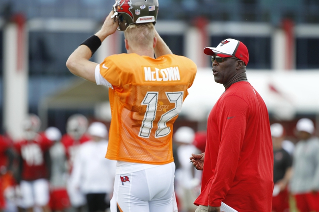 Jul 28, 2014; Tampa, FL, USA; Tampa Bay Buccaneers head coach Lovie Smith talks with quarterback Josh McCown (12) during training camp at One Buc Place. Mandatory Credit: Kim Klement-USA TODAY Sports