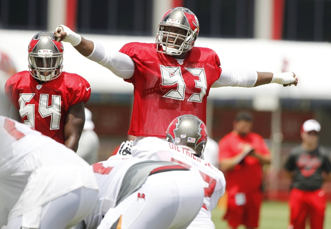 Jul 28, 2014; Tampa, FL, USA; Tampa Bay Buccaneers defensive tackle Gerald McCoy (93) calls a play during training camp at One Buc Place. Mandatory Credit: Kim Klement-USA TODAY Sports