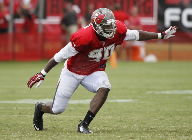 Jul 28, 2014; Tampa, FL, USA; Tampa Bay Buccaneers defensive end Michael Johnson (90) rushes during training camp at One Buc Place. Mandatory Credit: Kim Klement-USA TODAY Sports