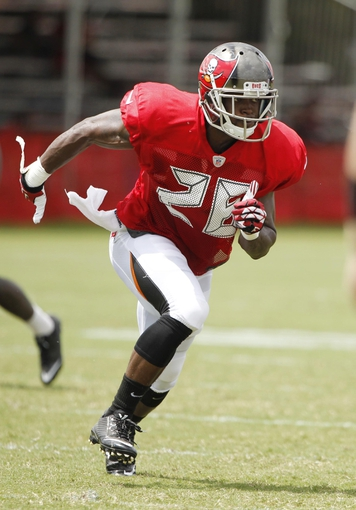 Jul 28, 2014; Tampa, FL, USA; Tampa Bay Buccaneers defensive back Quinton Pointer (26) rushes during training camp at One Buc Place. Mandatory Credit: Kim Klement-USA TODAY Sports