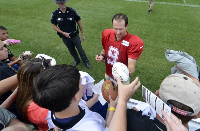 Jul 28, 2014; White Sulpher Springs, WV, USA;  New Orleans Saints quarterback Drew Brees (9) signs autographs following training camp at The Greenbrier. Mandatory Credit: Michael Shroyer-USA TODAY Sports