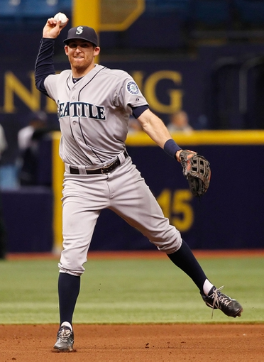 Jun 8, 2014; St. Petersburg, FL, USA; Seattle Mariners shortstop Brad Miller (5) throws the ball to first against the Tampa Bay Rays at Tropicana Field. Mandatory Credit: Kim Klement-USA TODAY Sports