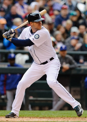 Apr 26, 2014; Seattle, WA, USA; Seattle Mariners designated hitter Corey Hart (27) waits for the pitch during the game against the Texas Rangers at Safeco Field. Texas defeated Seattle 6-3. Mandatory Credit: Steven Bisig-USA TODAY Sports