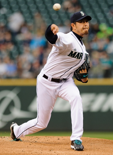 Jun 10, 2014; Seattle, WA, USA; Seattle Mariners starting pitcher Hisashi Iwakuma (18) pitches to the New York Yankees during the game at Safeco Field. New York defeated Seattle 3-2. Mandatory Credit: Steven Bisig-USA TODAY Sports