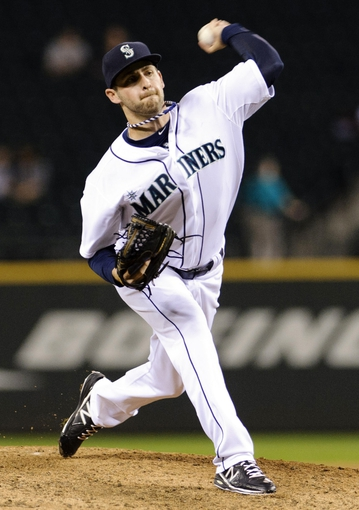 Sep 10, 2013; Seattle, WA, USA; Seattle Mariners relief pitcher Lucas Luetge (44) pitches to the Houston Astros during the 8th inning at Safeco Field. Mandatory Credit: Steven Bisig-USA TODAY Sports
