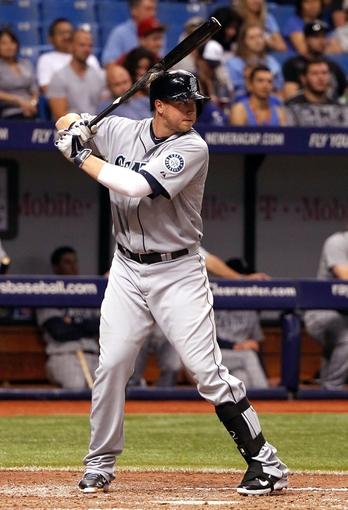 Jun 6, 2014; St. Petersburg, FL, USA; Seattle Mariners first baseman Justin Smoak (17) at bat against the Tampa Bay Rays  at Tropicana Field. Mandatory Credit: Kim Klement-USA TODAY Sports