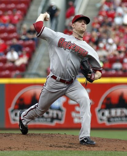 Jul 28, 2014; Cincinnati, OH, USA; Arizona Diamondbacks starting pitcher Chase Anderson (57) throws against the Cincinnati Reds in the first inning at Great American Ball Park. Mandatory Credit: David Kohl-USA TODAY Sports