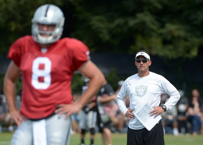 Jul 28, 2014; Napa, CA, USA; Oakland Raiders coach Dennis Allen (right) and quarterback Matt Schaub (8) at training camp at Napa Valley Marriott. Mandatory Credit: Kirby Lee-USA TODAY Sports