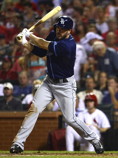 Jul 22, 2014; St. Louis, MO, USA; Tampa Bay Rays left fielder Matt Joyce (20) hits a one run double off of a St. Louis Cardinals starting pitcher during the fifth inning at Busch Stadium. Mandatory Credit: Jeff Curry-USA TODAY Sports