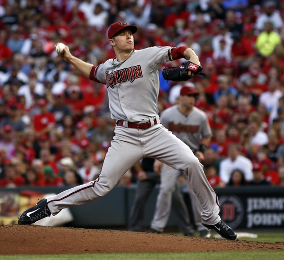 Jul 28, 2014; Cincinnati, OH, USA; Arizona Diamondbacks starting pitcher Chase Anderson (57) throws against the Cincinnati Reds at Great American Ball Park. The Diamondbacks won 2-1 in 15 innings. Mandatory Credit: David Kohl-USA TODAY Sports