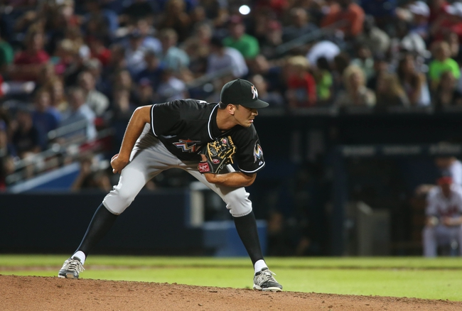 Jul 24, 2014; Atlanta, GA, USA; Miami Marlins relief pitcher Steve Cishek (31) prepares to deliver a pitch in the ninth inning of their game against the Atlanta Braves at Turner Field. Marlins won 3-2. Mandatory Credit: Jason Getz-USA TODAY Sports