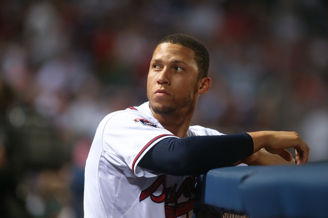 Jul 24, 2014; Atlanta, GA, USA; Atlanta Braves shortstop Andrelton Simmons (19) looks at the crowd from the dugout during their game against the Miami Marlins at Turner Field. Mandatory Credit: Jason Getz-USA TODAY Sports