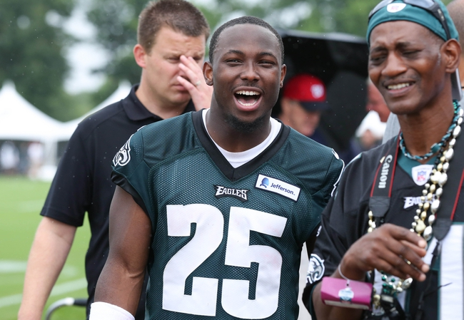 Jul 26, 2014; Philadelphia, PA, USA; Philadelphia Eagles running back LeSean McCoy (25) jokes around with fans after practice at training camp at the Novacare Complex in Philadelphia PA. Mandatory Credit: Bill Streicher-USA TODAY Sports