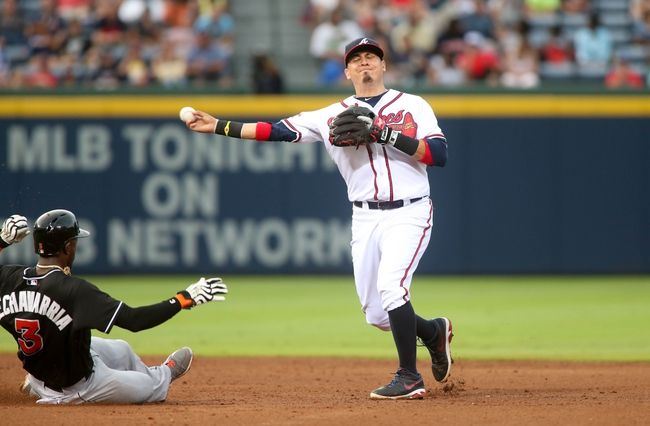 Jul 24, 2014; Atlanta, GA, USA; Atlanta Braves second baseman Ramiro Pena (14) avoids the collision with Miami Marlins shortstop Adeiny Hechavarria (3) on a force out in the fifth inning of their game at Turner Field. Marlins won 3-2. Mandatory Credit: Jason Getz-USA TODAY Sports