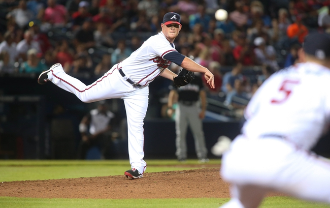 Jul 24, 2014; Atlanta, GA, USA; Atlanta Braves relief pitcher Craig Kimbrel (46) throws to Atlanta Braves first baseman Freddie Freeman (5) on a pickoff attempt of a Miami Marlins baserunner in the ninth inning of their game at Turner Field. Marlins won 3-2. Mandatory Credit: Jason Getz-USA TODAY Sports