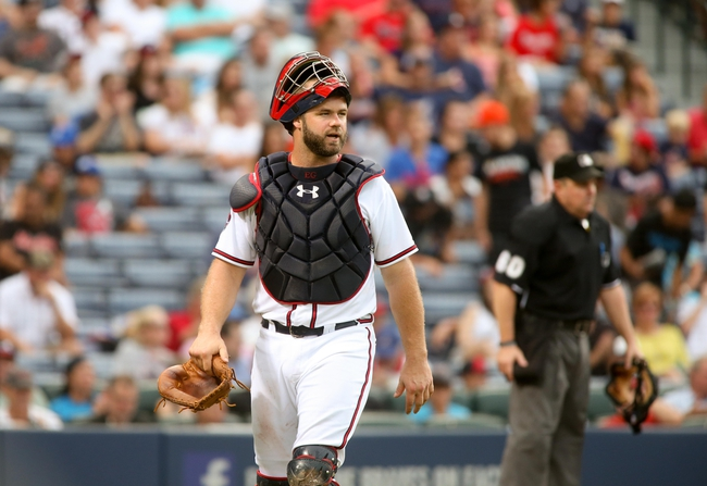 Jul 24, 2014; Atlanta, GA, USA; Atlanta Braves catcher Evan Gattis (24) walks to the dugout after the end of an inning during their game against the Miami Marlins at Turner Field. Marlins won 3-2. Mandatory Credit: Jason Getz-USA TODAY Sports