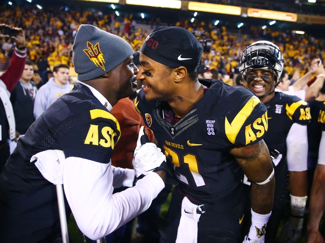 Nov 30, 2013; Tempe, AZ, USA; Arizona State Sun Devils wide receiver Jaelen Strong (right) celebrates with injured running back Marion Grice following the game against the Arizona Wildcats in the 87th annual Territorial Cup at Sun Devil Stadium. Arizona State defeated Arizona 58-21. Mandatory Credit: Mark J. Rebilas-USA TODAY Sports
