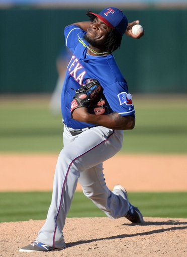 Mar 15, 2014; Phoenix, AZ, USA; Texas Rangers pitcher Roman Mendez (55) pitches in the ninth inning against the Oakland Athletics at Phoenix Municipal Stadium. The Rangers won 16-15. Mandatory Credit: Joe Camporeale-USA TODAY Sports