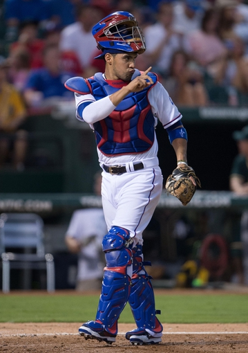 Jul 25, 2014; Arlington, TX, USA; Texas Rangers catcher Robinson Chirinos (61) during the game against the Oakland Athletics at Globe Life Park in Arlington. The Rangers defeated the Athletics 4-1. Mandatory Credit: Jerome Miron-USA TODAY Sports