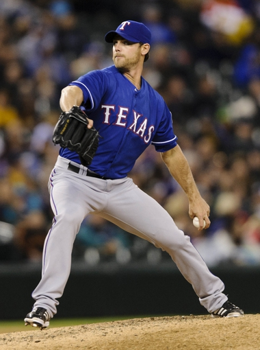 Apr 26, 2014; Seattle, WA, USA; Texas Rangers relief pitcher Neal Cotts (56) pitches to the Seattle Mariners during the eighth inning at Safeco Field. Texas defeated Seattle 6-3. Mandatory Credit: Steven Bisig-USA TODAY Sports