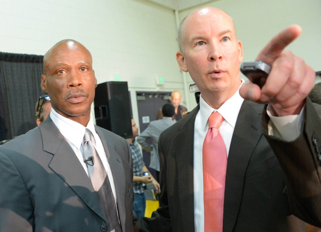 Jul 29, 2014; El Segundo, CA, USA; Los Angeles Lakers vice president of public relations John Black (right) escorts Byron Scott into a press conference to announce Scott as coach at Toyota Sports Center. Mandatory Credit: Kirby Lee-USA TODAY Sports