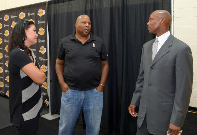 Jul 29, 2014; El Segundo, CA, USA; Byron Scott (right) talks with radio broadcasters Kristie Johnston (left) and Marc Q. Jones at press conference to announce his hiring as Los Angeles Lakers coach at Toyota Sports Center. Mandatory Credit: Kirby Lee-USA TODAY Sports