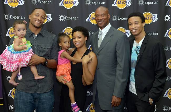 Jul 29, 2014; El Segundo, CA, USA; Byron Scott (second from right) poses with family members at press conference to announce his hiring as Los Angeles Lakers coach at Toyota Sports Center. Mandatory Credit: Kirby Lee-USA TODAY Sports