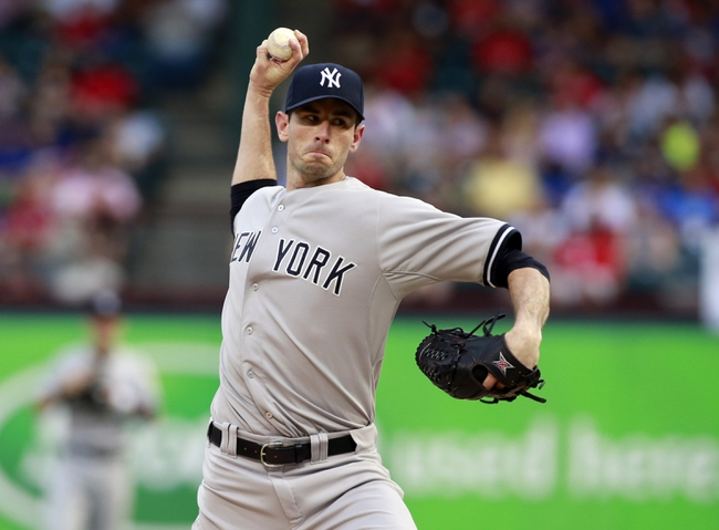 Jul 29, 2014; Arlington, TX, USA; /New York Yankees starting pitcher Brandon McCarthy (38) throws a pitch in the first inning against the Texas Rangers at Globe Life Park in Arlington. Mandatory Credit: Tim Heitman-USA TODAY Sports
