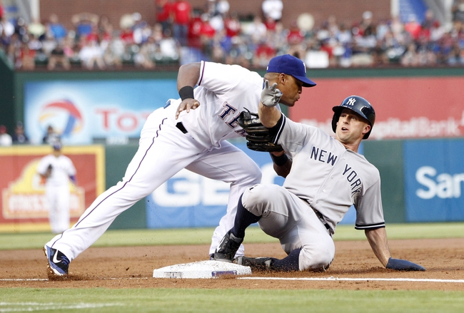 Jul 29, 2014; Arlington, TX, USA; Texas Rangers third baseman Adrian Beltre (29) tags out New York Yankees left fielder Brett Gardner (11) at third base in the third inning at Globe Life Park in Arlington. Mandatory Credit: Tim Heitman-USA TODAY Sports