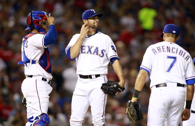 Jul 29, 2014; Arlington, TX, USA; Texas Rangers starting pitcher Nick Martinez (22) reacts to giving up a run in the sixth inning against the New York Yankees at Globe Life Park in Arlington. Mandatory Credit: Tim Heitman-USA TODAY Sports