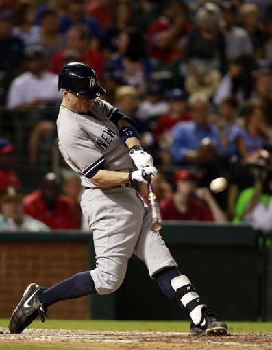 Jul 29, 2014; Arlington, TX, USA; New York Yankees second baseman Brendan Ryan (17) hits a double in the sixth inning against the Texas Rangers at Globe Life Park in Arlington. Mandatory Credit: Tim Heitman-USA TODAY Sports