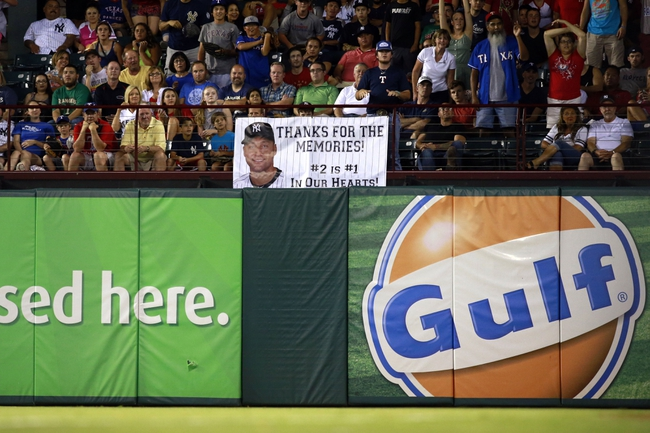 Jul 29, 2014; Arlington, TX, USA; A sign thanking New York Yankees shortstop Derek Jeter (2) on the outfield railing during the game against the Texas Rangers  at Globe Life Park in Arlington.  New York beat Texas 12-11. Mandatory Credit: Tim Heitman-USA TODAY Sports