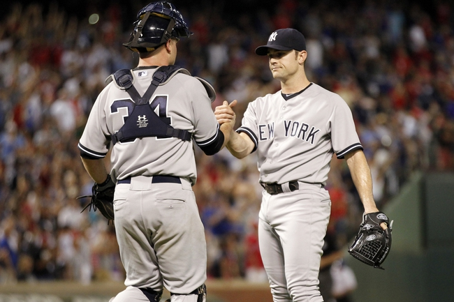 Jul 29, 2014; Arlington, TX, USA; New York Yankees catcher Brian McCann (34) congratulates  relief pitcher David Robertson (30) after the game against the Texas Rangers at Globe Life Park in Arlington.  New York beat Texas 12-11. Mandatory Credit: Tim Heitman-USA TODAY Sports