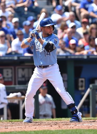 Jul 27, 2014; Kansas City, MO, USA; Kansas City Royals second basemen Omar Infante (14) at bat against the Cleveland Indians during the fifth inning at Kauffman Stadium. Mandatory Credit: Peter G. Aiken-USA TODAY Sports