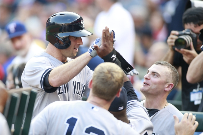 Jul 30, 2014; Arlington, TX, USA; New York Yankees left fielder Brett Gardner (11) is congratulated by his teammates after hitting a home run in the first inning against the Texas Rangers at Globe Life Park in Arlington. Mandatory Credit: Tim Heitman-USA TODAY Sports