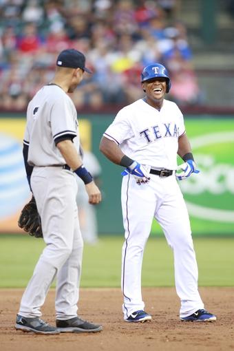 Jul 30, 2014; Arlington, TX, USA; Texas Rangers third baseman Adrian Beltre (29) laughs with New York Yankees shortstop Derek Jeter (2) during the first inning at Globe Life Park in Arlington. Mandatory Credit: Tim Heitman-USA TODAY Sports