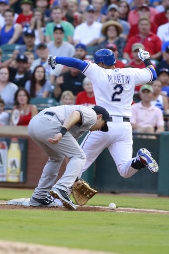Jul 30, 2014; Arlington, TX, USA; New York Yankees first baseman Mark Teixeira (25) lets a ball hit by Texas Rangers center fielder Leonys Martin (2) roll foul in the first inning at Globe Life Park in Arlington. Mandatory Credit: Tim Heitman-USA TODAY Sports