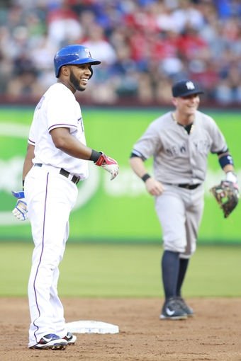 Jul 30, 2014; Arlington, TX, USA; Texas Rangers shortstop Elvis Andrus (1) smiles on second base after hitting a double in the first inning against the New York Yankees at Globe Life Park in Arlington. Mandatory Credit: Tim Heitman-USA TODAY Sports