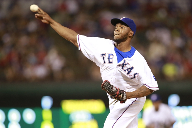 Jul 30, 2014; Arlington, TX, USA; Texas Rangers relief pitcher Neftali Feliz (30) throws a pitch in the ninth inning against the New York Yankees at Globe Life Park in Arlington. Texas beat New York 3-2. Mandatory Credit: Tim Heitman-USA TODAY Sports