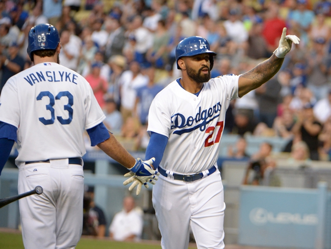 Jul 30, 2014; Los Angeles, CA, USA; Los Angeles Dodgers right fielder Matt Kemp (27) is congratulated by left fielder Scott Van Slyke (33) after hitting a solo home run in the second inning against the Atlanta Braves at Dodger Stadium. Mandatory Credit: Kirby Lee-USA TODAY Sports