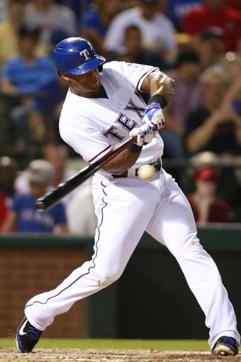 Jul 30, 2014; Arlington, TX, USA; Texas Rangers third baseman Adrian Beltre (29) singles in the fifth inning against the New York Yankees at Globe Life Park in Arlington.  Texas beat New York 3-2. Mandatory Credit: Tim Heitman-USA TODAY Sports