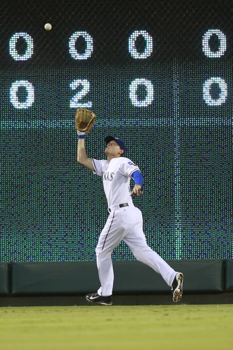 Jul 30, 2014; Arlington, TX, USA; Texas Rangers left fielder Jim Adduci (35) catches a fly ball during the fifth inning against the New York Yankees at Globe Life Park in Arlington.  Texas beat New York 3-2. Mandatory Credit: Tim Heitman-USA TODAY Sports