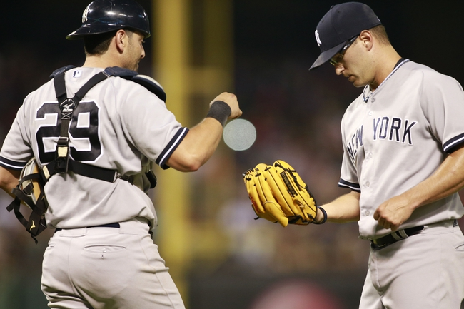 Jul 30, 2014; Arlington, TX, USA; New York Yankees catcher Francisco Cervelli (29) approaches relief pitcher David Huff (55) during the eighth inning against the Texas Rangers at Globe Life Park in Arlington.  Texas beat New York 3-2. Mandatory Credit: Tim Heitman-USA TODAY Sports
