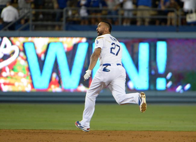 Jul 30, 2014; Los Angeles, CA, USA; Los Angeles Dodgers right fielder Matt Kemp (27) celebrates after a walk-off single in the 10th inning against the Atlanta Braves at Dodger Stadium. The Dodgers defeated the Braves 2-1 in 10 innings. Mandatory Credit: Kirby Lee-USA TODAY Sports
